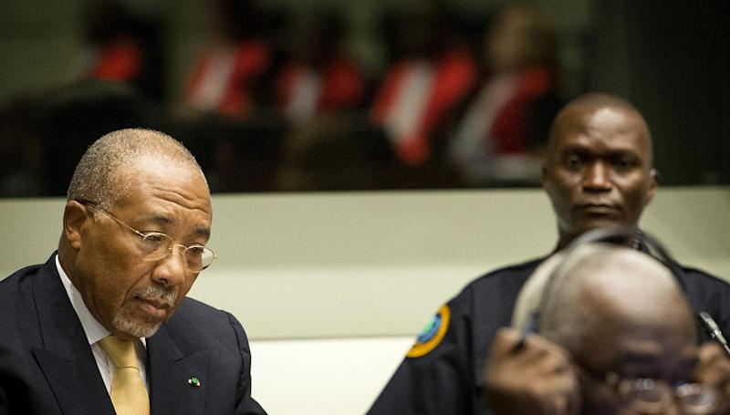Former Liberian President Charles Taylor, left, waits for the start of his appeal judgement at the Special Court for Sierra Leone (SCSL) in Leidschendam, near The Hague, Netherlands, Thursday Sept. 26, 2013. Judges at a U.N.-backed tribunual are delivering their judgment in Taylor's appeal against his convictions and 50-year sentence for planning and aiding atrocities by rebels in Sierra Leone's bloody civil war. Taylor, 65, became the first former head of state convicted by an international war crimes court since World War II when the SCSL found him guilty on April 26, 2012, of 11 counts of war crimes and crimes against humanity including terrorism, murder, rape and using child soldiers. (AP Photo/Koen van Weel, Pool)