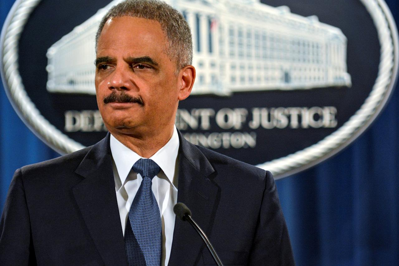 FILE PHOTO: Then U.S. Attorney General Eric Holder, addresses a Justice Department news conference in Washington, U.S., March 4, 2015.  REUTERS/James Lawler Duggan/File Photo