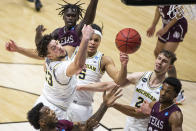 Michigan's Brandon Johns Jr. (23), Terrance Williams II (5), and Franz Wagner (21) compete for a rebound with Texas Southern's Justin Hopkins, left, and Quinton Brigham, right, during the first half of a First Round game in the NCAA men's college basketball tournament, Saturday, March 20, 2021, at Mackey Arena in West Lafayette, Ind. (AP Photo/Robert Franklin)