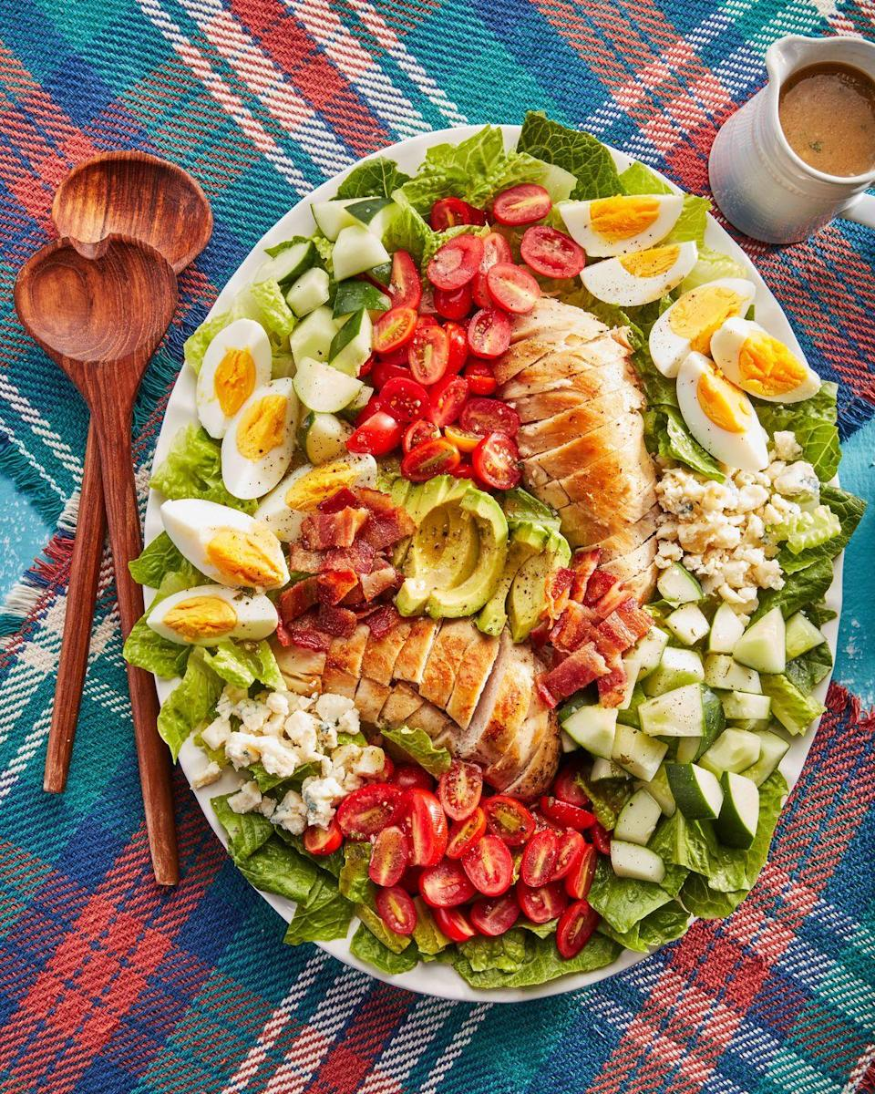"""<p>The trick to making this super-hearty summer salad extra fast? Rotisserie chicken breast, which comes already cooked! </p><p><strong><a href=""""https://www.countryliving.com/food-drinks/a36343286/basic-cobb-salad-recipe/"""" rel=""""nofollow noopener"""" target=""""_blank"""" data-ylk=""""slk:Get the recipe"""" class=""""link rapid-noclick-resp"""">Get the recipe</a>.</strong></p>"""