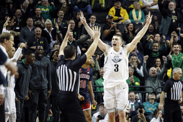 FILE - In this Jan. 9, 2020, file photo, Oregon's Payton Pritchard (3) celebrates a three-point basket that put the team ahead of Arizona during the second half of an NCAA college basketball game in Eugene, Ore. Pritchard was selected to The Associated Press All-America first team, Friday, March 20, 2020. (AP Photo/Thomas Boyd, File)