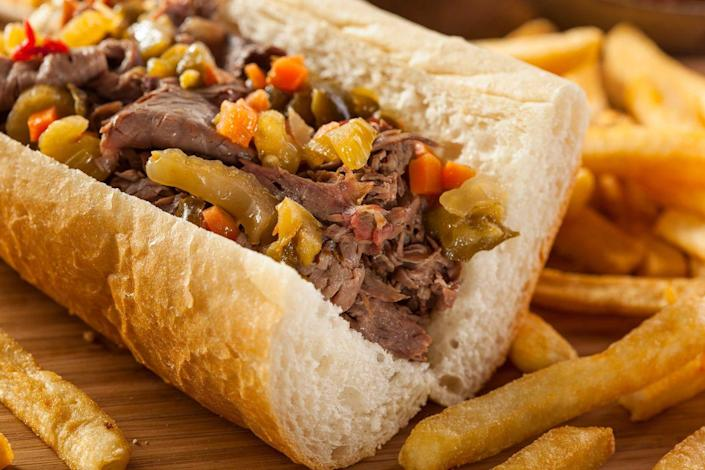 """<p><strong>Italian Beef Sandwich</strong></p><p>Italian immigrants started making Italian Beef Sandwiches on Chicago's South Side in the 1930's. Now available everywhere in Chicago, the supposed originator is <a href=""""https://www.alsbeef.com/"""" rel=""""nofollow noopener"""" target=""""_blank"""" data-ylk=""""slk:Al's"""" class=""""link rapid-noclick-resp"""">Al's</a> -- dry roasted beef coated in a secret blend of spices, topped with peppers inside a rich roll. You can get it """"wet"""", with extra meat juice poured on like gravy.</p>"""