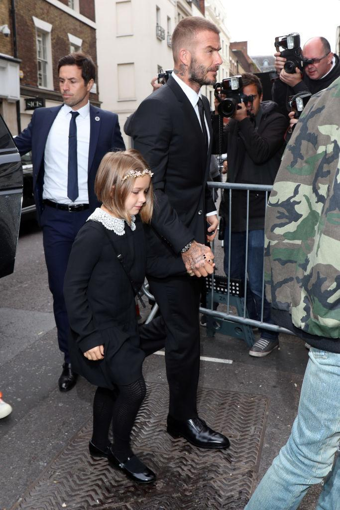 David Beckham arrived at the 10th anniversary show hand-in-hand with the couple's daughter, Harper [Photo: Getty]