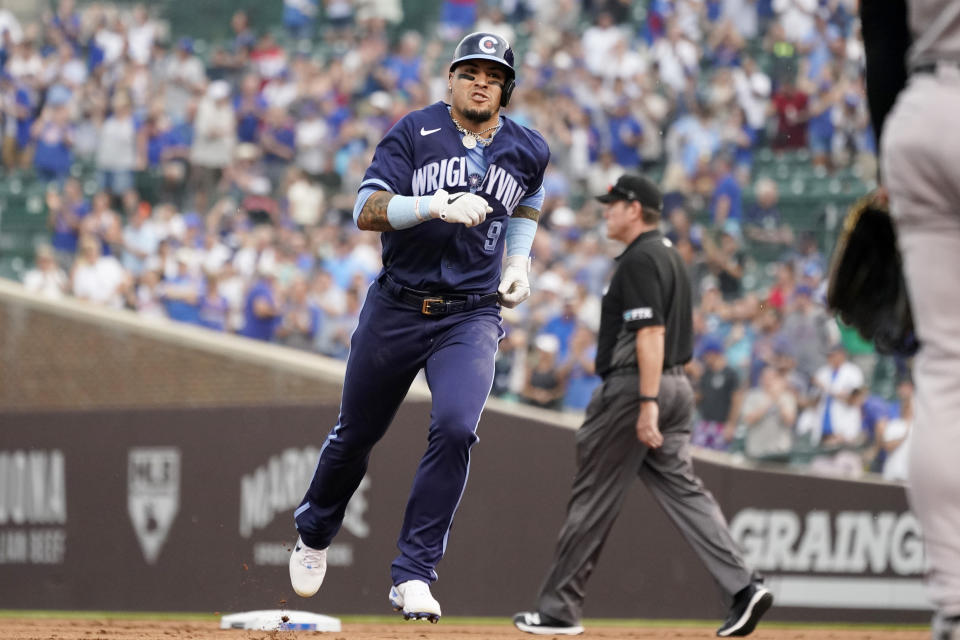 Chicago Cubs' Javier Baez rounds the bases after hitting a three-run home run during the first inning of a baseball game against the Arizona Diamondbacks in Chicago, Friday, July 23, 2021. (AP Photo/Nam Y. Huh)