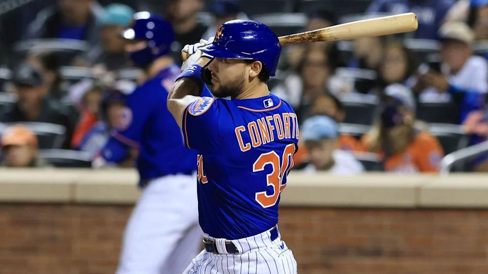 Sep 30, 2021; New York City, New York, USA; New York Mets right fielder Michael Conforto (30) hits an RBI single during the third inning against the Miami Marlins at Citi Field.