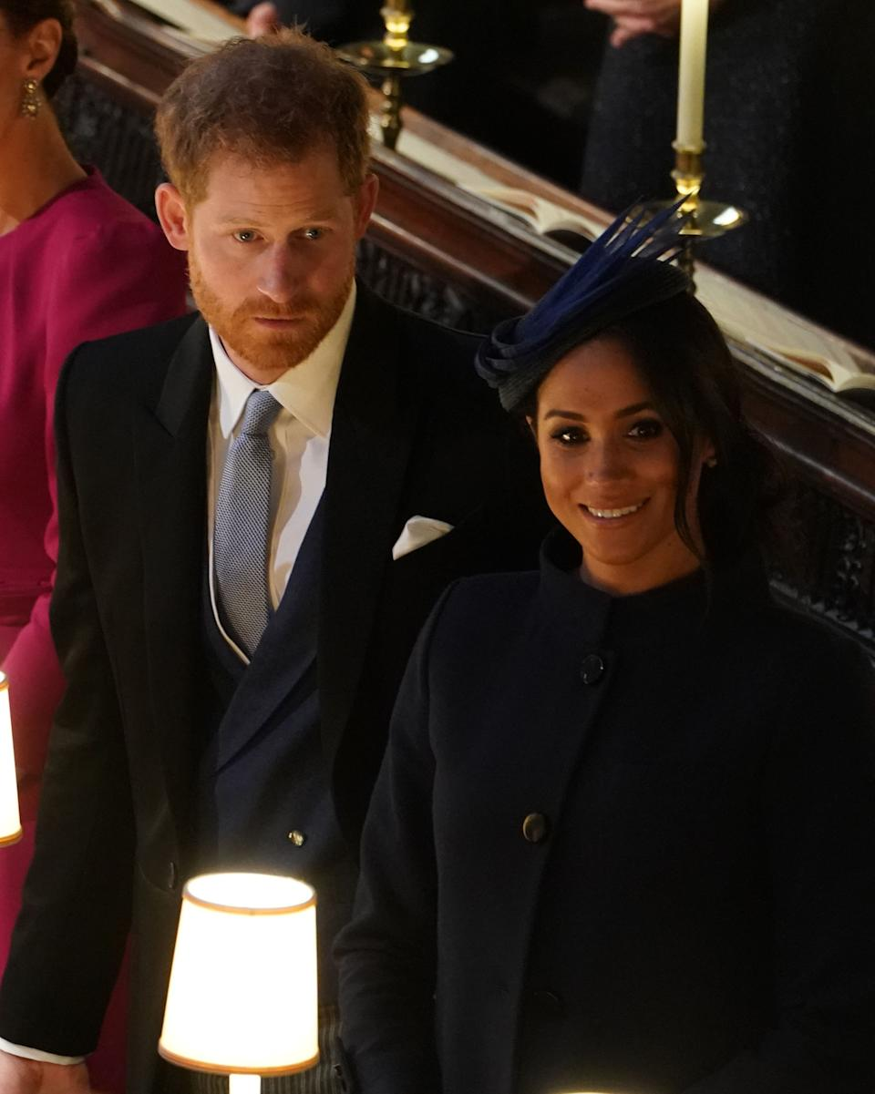 Britain's Prince Harry, Duke of Sussex, and Meghan, Duchess of Sussex attend the wedding ceremony of Britain's Princess Eugenie of York (C) and Jack Brooksbank at St George's Chapel, Windsor Castle, in Windsor, on October 12, 2018. (Photo by Owen Humphreys / POOL / AFP)        (Photo credit should read OWEN HUMPHREYS/AFP via Getty Images)