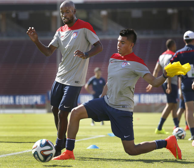United States' DaMarcus Beasley, left, and his teammate Joe Corona, fight for the ball during a training session on Wednesday, May 14, 2014, Stanford, Calif. The US national soccer team kicked off its preparation camp at Stanford University preparing for the World Cup tournament, which gets underway in June. (AP Photo/Tony Avelar)