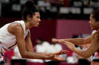 United States' Jordan Thompson, left, and United States' Justine Wong-Orantes celebrate winning a point during the women's volleyball preliminary round pool B match between China and United States at the 2020 Summer Olympics, Tuesday, July 27, 2021, in Tokyo, Japan. (AP Photo/Frank Augstein)