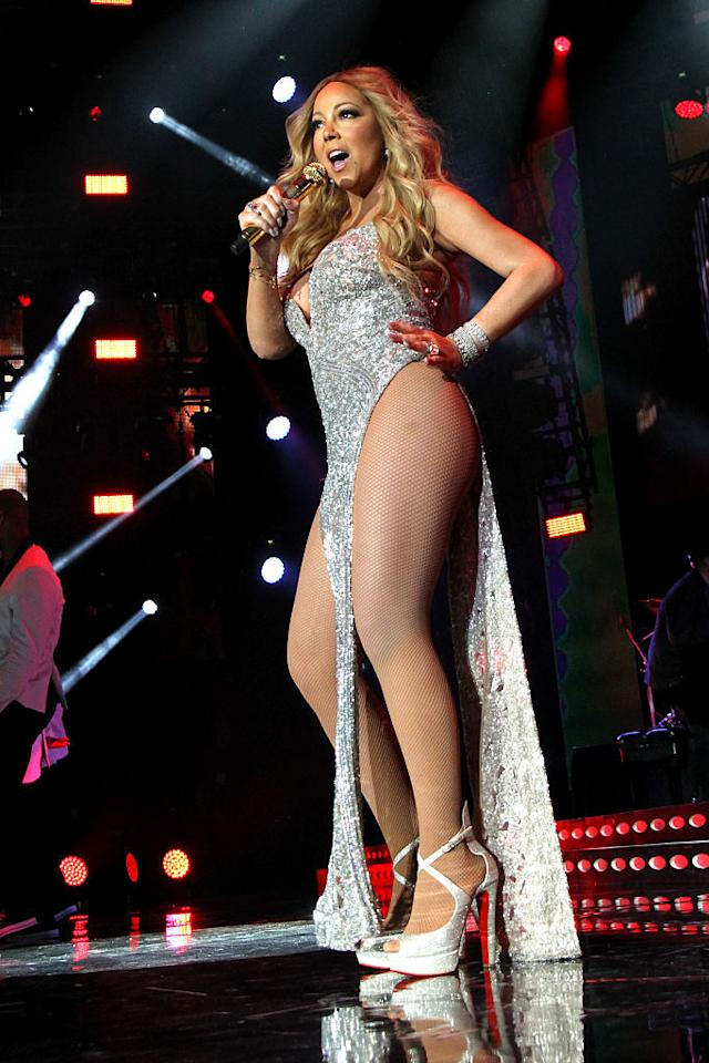 <p>Well then! The diva songstress made sure all eyes were on her when she performed at the <em>Essence</em> Festival in July. Her sparkly dress had just two dangling strips of fabric, in the front and back, with hip-exposing sides. (Photo: Getty Images) </p>