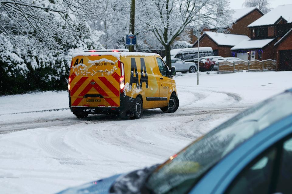 STOURBRIDGE, ENGLAND - DECEMBER 28: A AA van struggles in the snow as heavy snowfall falls down on the West Midlands overnight on December 28, 2020 in Stourbridge, England. Heavy snow fall has covered the West Midlands as the Met Office issues yellow warnings throughout the day. (Photo by Cameron Smith/Getty Images)