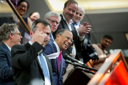 Dean Baquet (C), executive editor of The New York Times, celebrates the announcement of the 2017 Pulitzer Prizes in The Times office in New York, U.S., April 10, 2017. Sam Hodgson/Courtesy The New York Times/Handout via REUTERS