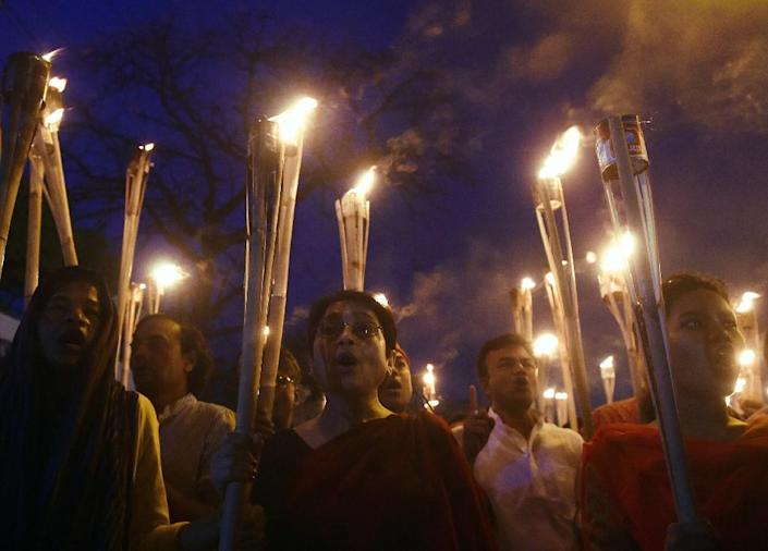 Bangladeshi secular activists take part in a torch-lit protest against the killing of Avijit Roy, a blogger who was hacked to death, in Dhaka, on February 27, 2015 (AFP Photo/Munir Uz Zaman)