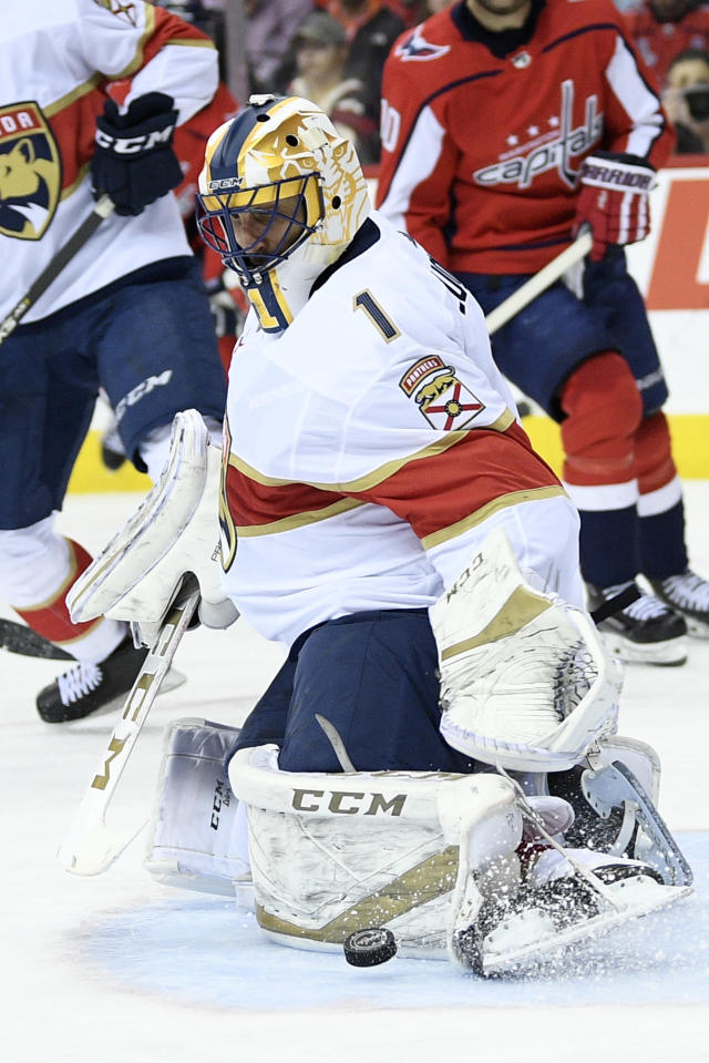 Florida Panthers goaltender Roberto Luongo (1) stops the puck during the third period of the team's NHL hockey game against the Washington Capitals, Saturday, Feb. 9, 2019, in Washington. The Panthers won 5-4 in overtime. (AP Photo/Nick Wass)