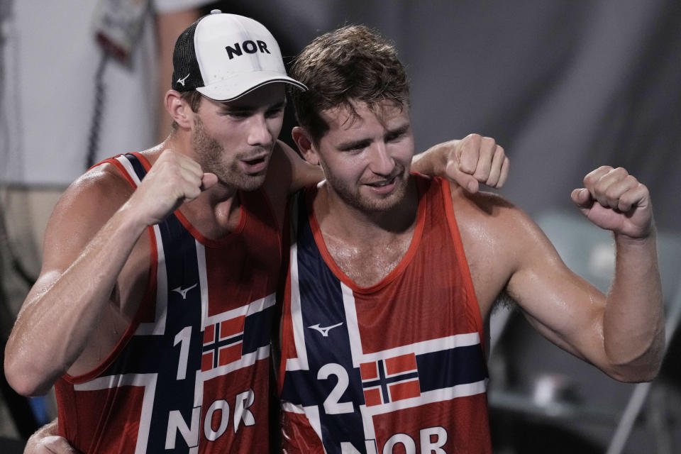 Anders Berntsen Mol, left, of Norway, and teammate Christian Sandlie Sorum, celebrate winning a men's beach volleyball semifinal match against Latvia at the 2020 Summer Olympics, Thursday, Aug. 5, 2021, in Tokyo, Japan. (AP Photo/Petros Giannakouris)