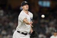 New York Yankees relief pitcher Clay Holmes throws out Texas Rangers' Leody Taveras at first base during the seventh inning of a baseball game Monday, Sept. 20, 2021, in New York. (AP Photo/Frank Franklin II)