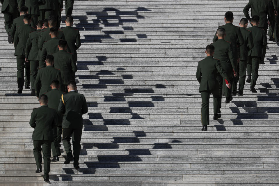 Chinese paramilitary policemen arrive to the Great Hall of the People to attend the commemorating conference on the 70th anniversary of China's entry into the 1950-53 Korean War, in Beijing Friday, Oct. 23, 2020. (AP Photo/Andy Wong)