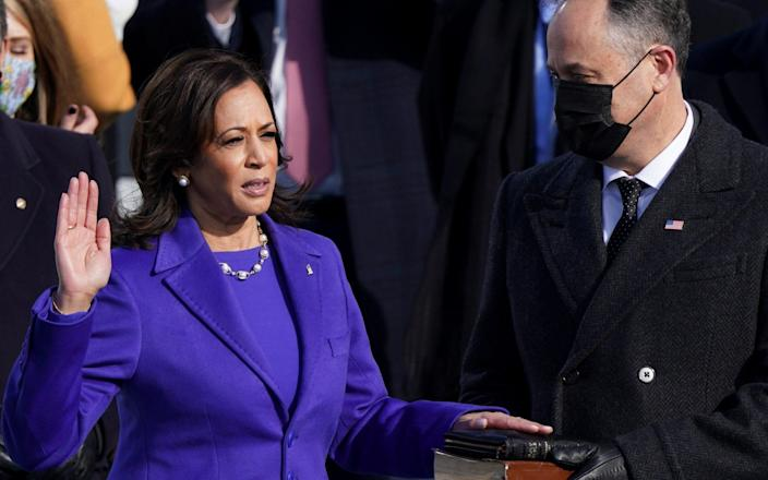 Kamala Harris is sworn in as U.S. Vice President as her spouse Doug Emhoff holds a bible during the inauguration of Joe Biden as the 46th President of the United States on the West Front of the U.S. Capitol in Washington, U.S., January 20, 2021. - REUTERS