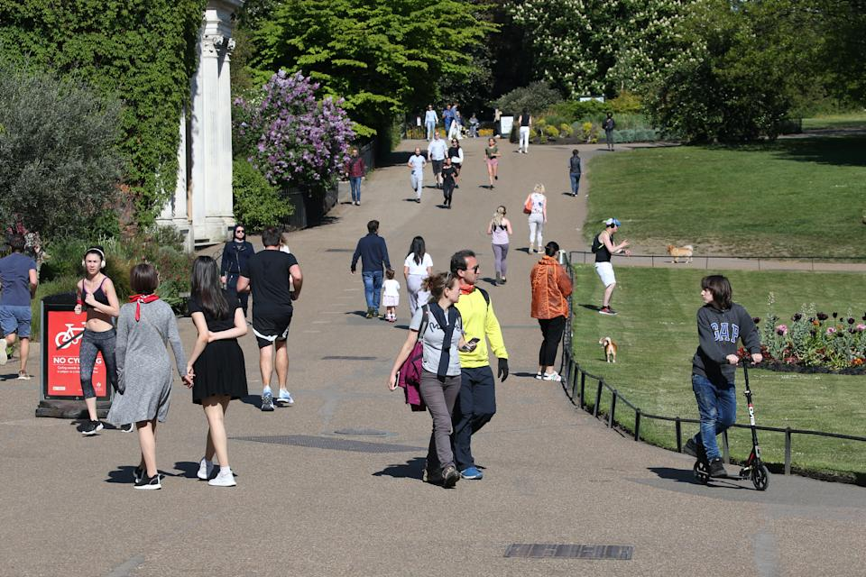 People walking in Kensington Gardens, London, as the UK continues in lockdown to help curb the spread of the coronavirus. (Photo by Jonathan Brady/PA Images via Getty Images)