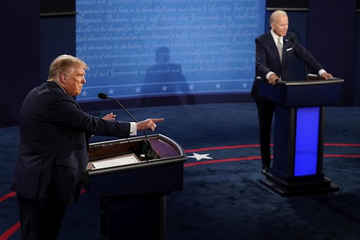 President Donald Trump makes a points as Democratic presidential candidate former Vice President Joe Biden listens during the first presidential debate Tuesday, Sept. 29, 2020, at Case Western University and Cleveland Clinic, in Cleveland, Ohio. (AP Photo/Morry Gash, Pool)
