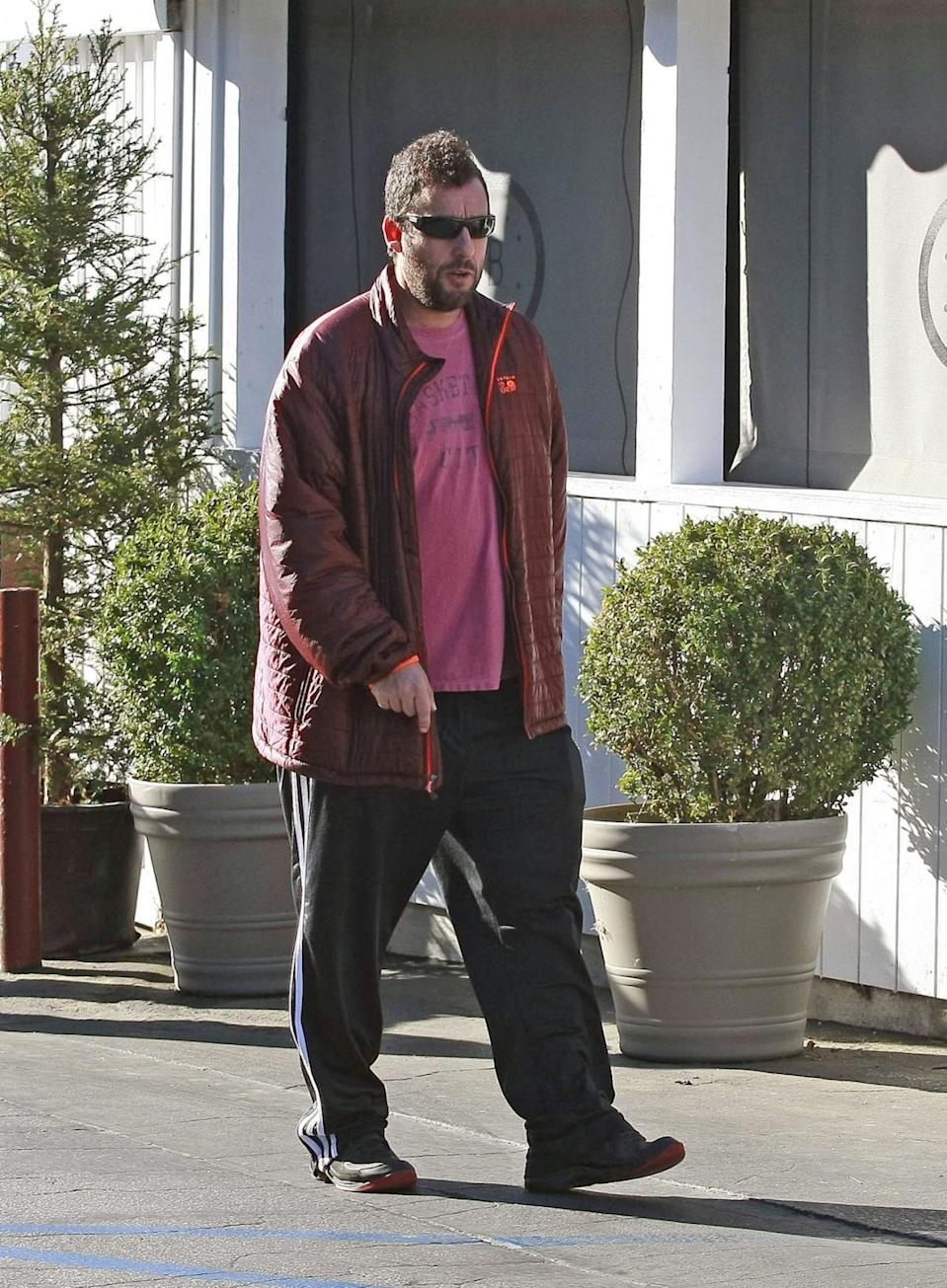 <p>Sandler, we'd recognize those track pants anywhere! (Photo: Bauer-Griffin/FilmMagic)</p>