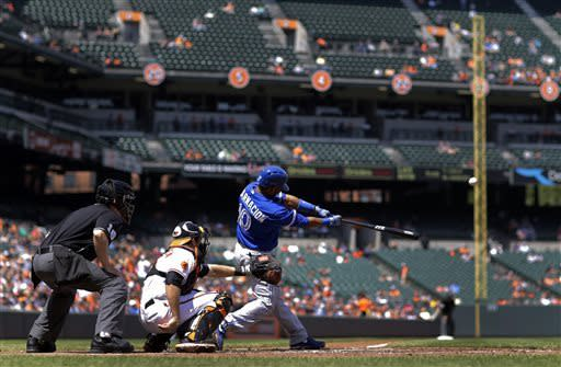 Toronto Blue Jays' Edwin Encarnacion hits a solo home run in the fourth inning of a baseball game against the Baltimore Orioles on Wednesday, April 24, 2013, in Baltimore. (AP Photo/Patrick Semansky)