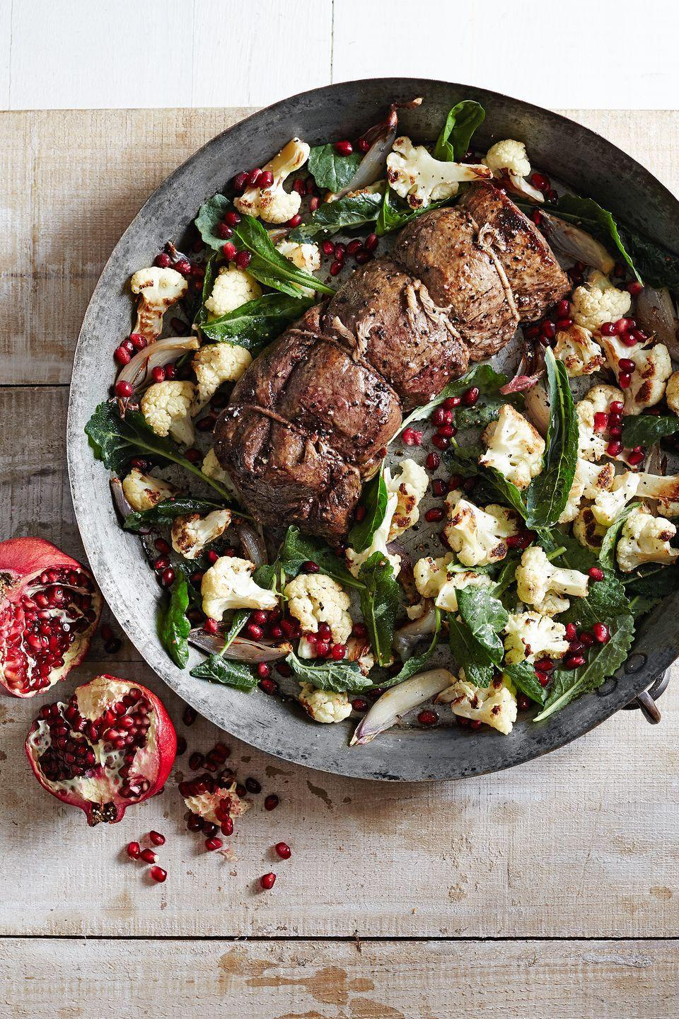 "<p>This juicy beef tenderloin is brightened by a tangy cauliflower-pomegranate salad that is sure to satisfy any crowd.</p><p><strong><a href=""https://www.countryliving.com/food-drinks/recipes/a6207/beef-tenderloin-roasted-cauliflower-pomegranate-salad-recipe-clx1214/"" rel=""nofollow noopener"" target=""_blank"" data-ylk=""slk:Get the recipe"" class=""link rapid-noclick-resp"">Get the recipe</a>.</strong></p><p><strong><a class=""link rapid-noclick-resp"" href=""https://www.amazon.com/Nordic-Ware-Natural-Aluminum-Commercial/dp/B0049C2S32/?tag=syn-yahoo-20&ascsubtag=%5Bartid%7C10050.g.738%5Bsrc%7Cyahoo-us"" rel=""nofollow noopener"" target=""_blank"" data-ylk=""slk:SHOP BAKING SHEETS"">SHOP BAKING SHEETS</a><br></strong></p>"