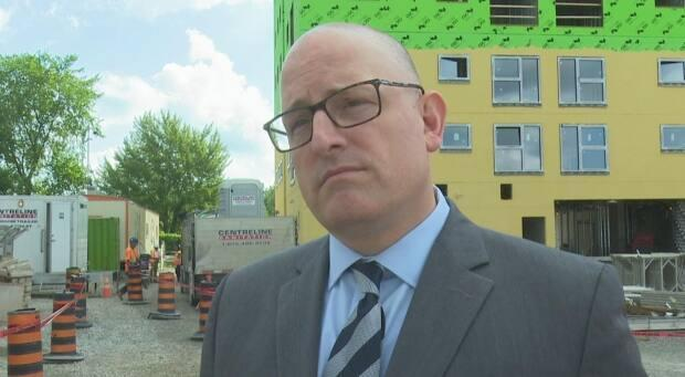 """""""Some of these are really easy, low hanging fruit. Others I recognize, will take a lengthier period of time, more collaboration amongst all levels of government in order to get traction on it,"""" Mayor Dilkens said.   (Chris Ensing/CBC - image credit)"""