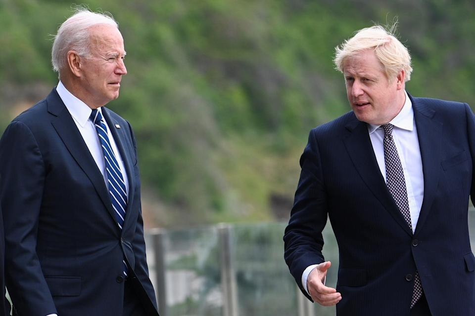 Biden and Johnson are pictured at the G7 summit earlier this year (PA)