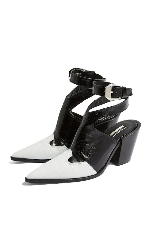 """<p><strong>Topshop</strong></p><p>topshop.com</p><p><strong>$140.00</strong></p><p><a href=""""http://us.topshop.com/en/tsus/product/huxley-high-ankle-boot-8349874"""" target=""""_blank"""">SHOP IT</a></p><p>Go sockless! This pair, which looks like a cross between a sandal and a mule, features a backless cut and ankle straps. The design also has a western influence for those who want that vibe, but aren't in the market for an actual pair of cowboy boots. </p>"""