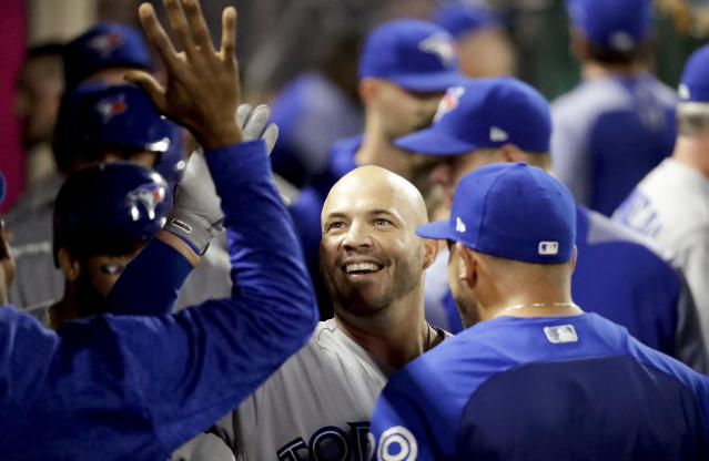 Toronto Blue Jays' Steve Pearce celebrates in the dugout after his three-run home run against the Los Angeles Angels during the ninth inning of a baseball game in Anaheim, Calif., Saturday, June 23, 2018. (AP Photo/Chris Carlson)