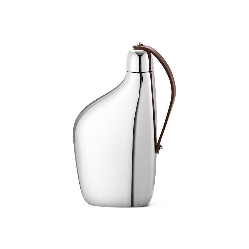 """<p>House something a little stronger in style with Georg Jensen's shining flask. Crafted from stainless steel, it's ergonomically designed and draws inspiration from the pure organic shapes of clouds. FC</p><p>£60, <a href=""""https://www.harrods.com/en-gb/shopping/sky-hip-flask-15001122?utm_source=google_uk&utm_medium=shopping&utm_campaign=home_and_furniture&utm_content=georg_jensen_15001122-7983&gclid=CjwKCAjwj6SEBhAOEiwAvFRuKAwFTpSsqvcRN7L_M81AeJhvuXPZR4JEN4aVv8dr7AR20AeJ1LTFtBoCqdUQAvD_BwE&gclsrc=aw.ds"""" rel=""""nofollow noopener"""" target=""""_blank"""" data-ylk=""""slk:Harrods"""" class=""""link rapid-noclick-resp"""">Harrods</a>.<br></p>"""