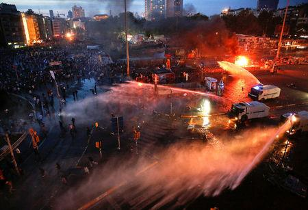 FILE PHOTO: Turkish police use water cannons to disperse protesters at Taksim square in Istanbul