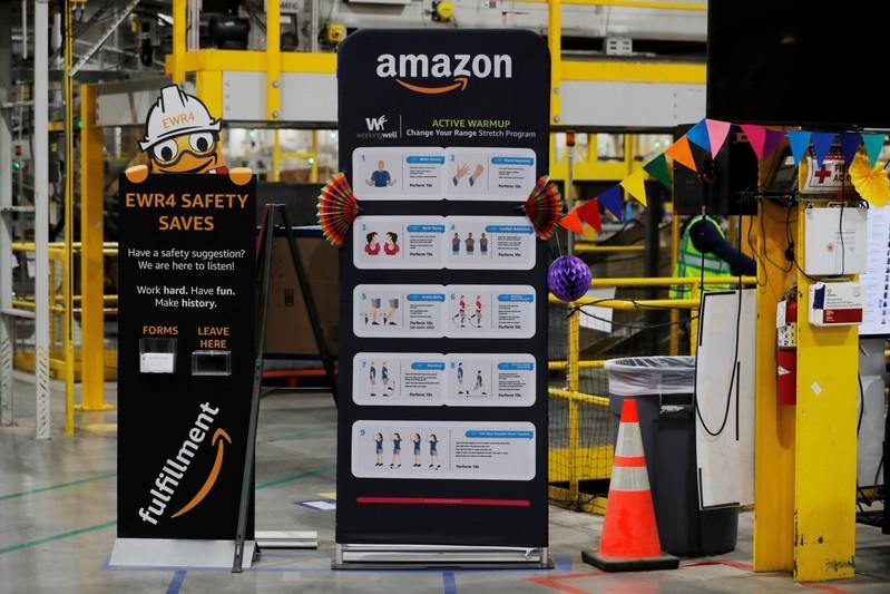Exercise tips and safety instructions are displayed inside of an Amazon fulfillment center on Cyber Monday in Robbinsville, New Jersey