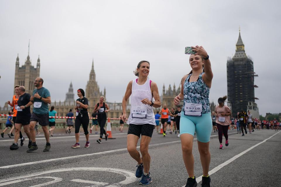 A runner takes a selfie on Westminster Bridge (Victoria Jones/PA) (PA Wire)