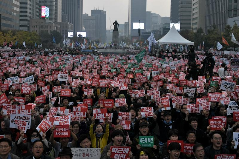 The largely peaceful rallies in Seoul have been growing in size over the past month, attracting an estimated one million people earlier in November, and are among the largest seen in South Korea since the pro-democracy protests of the 1980s (AFP Photo/Ed Jones)