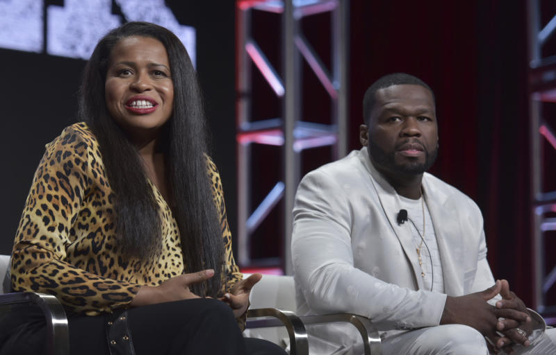 "Creator/executive producer Courtney A. Kemp, left, and Curtis ""50 Cent"" Jackson participate in the Starz ""Power"" panel at the Television Critics Association Summer Press Tour on Friday, July 26, 2019, in Beverly Hills, Calif. (Photo by Richard Shotwell/Invision/AP)"