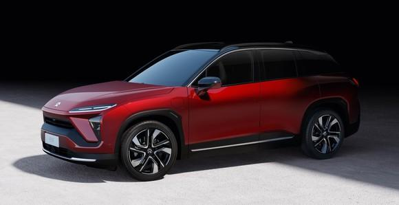 A red NIO ES6, a five-passenger electric luxury SUV.