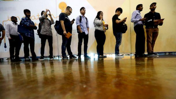 PHOTO: In this Sept. 17, 2019, photo job seekers line up to speak to recruiters during an Amazon job fair in Dallas. (Lm Otero/AP, FILE)