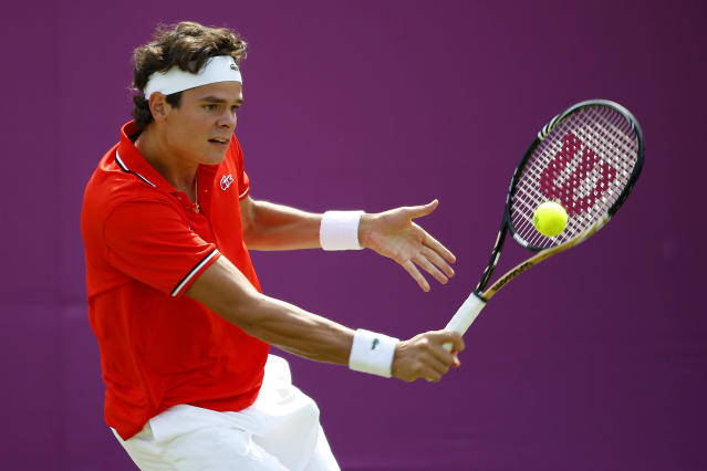 LONDON, ENGLAND - JULY 30: Milos Raonic of Canada plays a backhand during the Men's Singles Tennis match against Tatsuma Ito of Japan on Day 3 of the London 2012 Olympic Games at the All England Lawn Tennis and Croquet Club in Wimbledon on July 30, 2012 in London, England. (Photo by Jamie Squire/Getty Images)