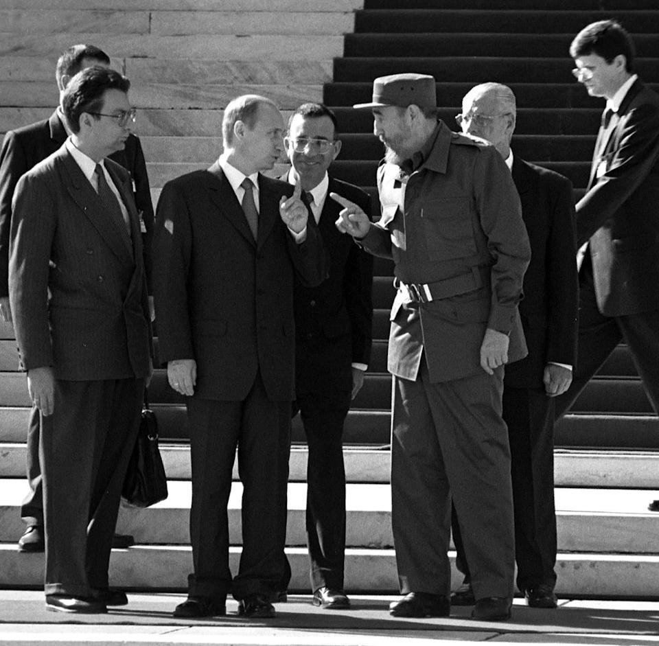 """<p>Fidel Castro, pictured with Russian President, Vladimir Putin, at the """"Palace of the Revolution,"""". Putin it is the first president of Russia ex-comunist that Cuba view, after the fall of the """"Wall of Berlin"""". December 14, 2000. (Jorge Rey/MediaPunch/IPX/AP) </p>"""