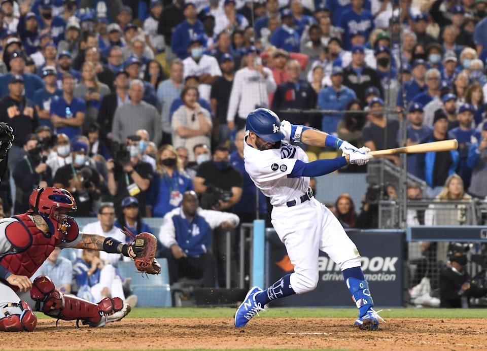 Los Angeles Dodgers' Chris Taylor hits the game-winning two-run home run against the Cardinals. (Wally Skalij / Los Angeles Times via Getty Images)