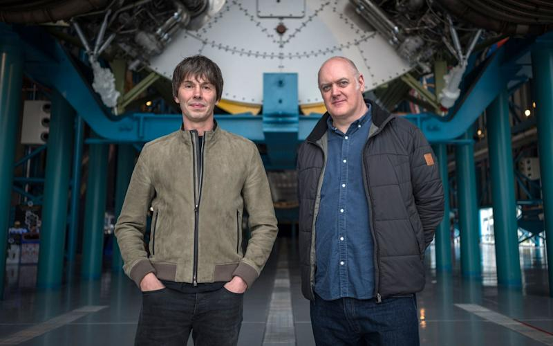 Professor Brian Cox and Dara Ó Briain in front of a Saturn V rocket - WARNING: Use of this copyright image is subject to the terms of use of BBC Pictures' Digital Picture Service (BBC Pictures) as set out at www.bbcpictures.co.uk. In particular, this image may only be published by a registered User of BBC Pictures for editorial use for the purpose of publicising the relevant BBC programme, personnel or activity during the Publicity Period which ends three review weeks following the date of transmission and provided the BBC and the copyright holder in the caption are credited. For any other purpose whatsoever, including advertising and commercial, prior written approval from the copyright holder will be required.