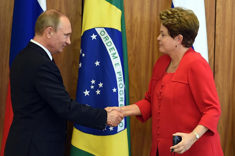 Russian President Vladimir Putin and Brazilian President Dilma Rousseff shake hands during a meeting at Planalto Palace in Brasilia on July 14, 2014