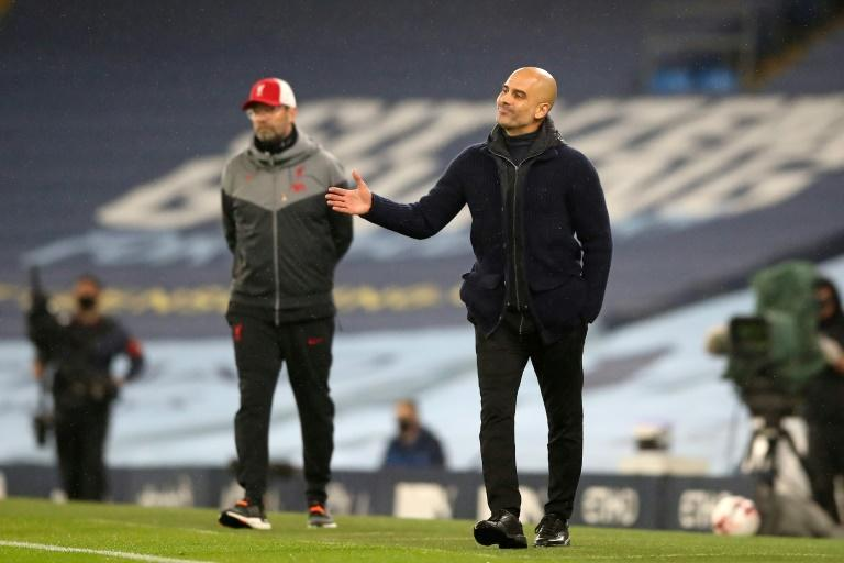 Manchester City boss Pep Guardiola (right) and Liverpool boss Jurgen Klopp shared the spoils in a 1-1 draw at the Etihad