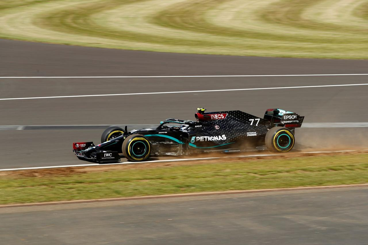 <p>Mercedes' Finnish driver Valtteri Bottas steers his car during the qualifying session for the Formula One British Grand Prix at the Silverstone motor racing circuit in Silverstone, central England on August 1, 2020.</p>