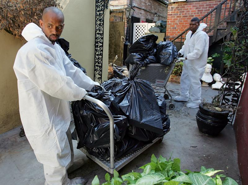 Following Katrina, Cedric Harrell (left) and Tom Miller remove spoiled food from the freezer at Court of Two Sisters restaurant in the French Quarter of New Orleans. (Ethan Miller/Getty Images)