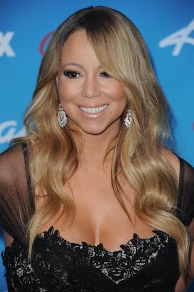 "FILE - In this March 7, 2013 file photo, Mariah Carey attends the meet the ""American Idol"" finalist event at The Grove in Los Angeles. With reported paychecks of $18 million for Carey, $12 million for Nicki Minaj and $6 million for Keith Urban, there hasn't been a return on investment. The ratings have never been lower for ""Idol,"" which for nine seasons was the most-watched show on TV. (Photo by Richard Shotwell/Invision/AP, File)"