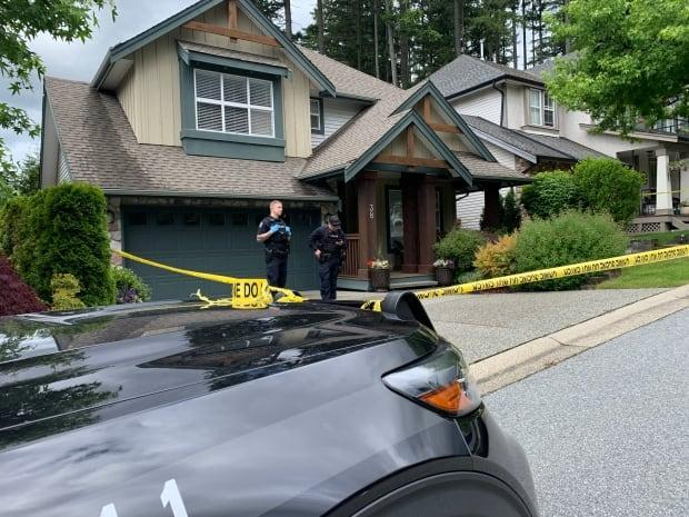 On Saturday, police put tape around the Port Moody home of Trina Hunt, who has been deemed the victim of a homicide. (Yvette Brend/CBC News - image credit)