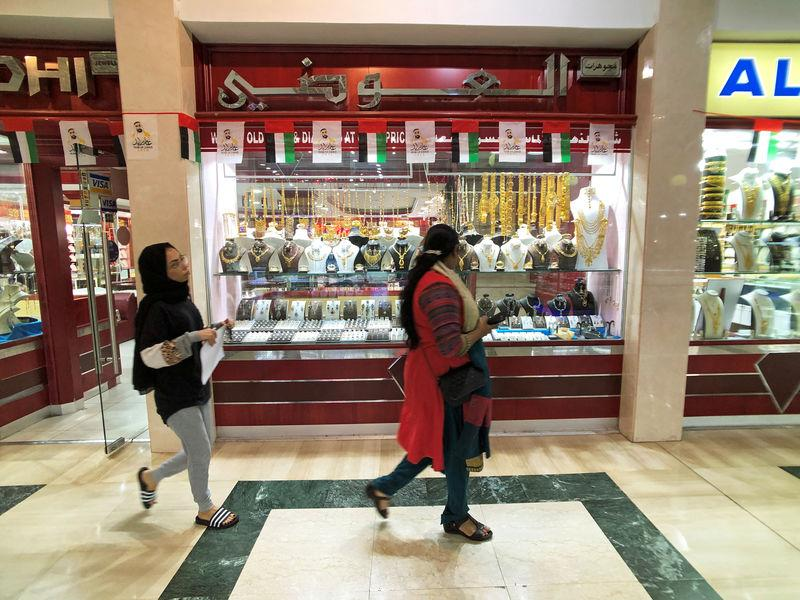 FILE PHOTO - People walk in front of a gold shop in Gold Souq in Abu Dhabi