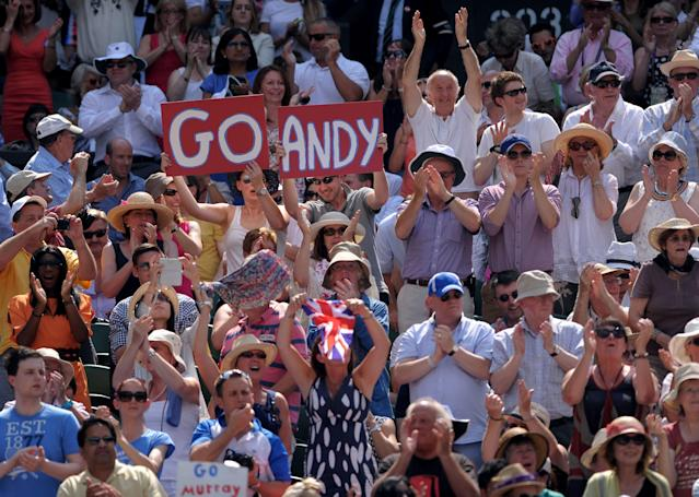 Fans in the crowd show their support for Great Britain's Andy Murray during his match against Serbia's Novak Djokovic on day thirteen of the Wimbledon Championships at The All England Lawn Tennis and Croquet Club, Wimbledon.